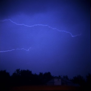 caption of flashes in a thunderstorm